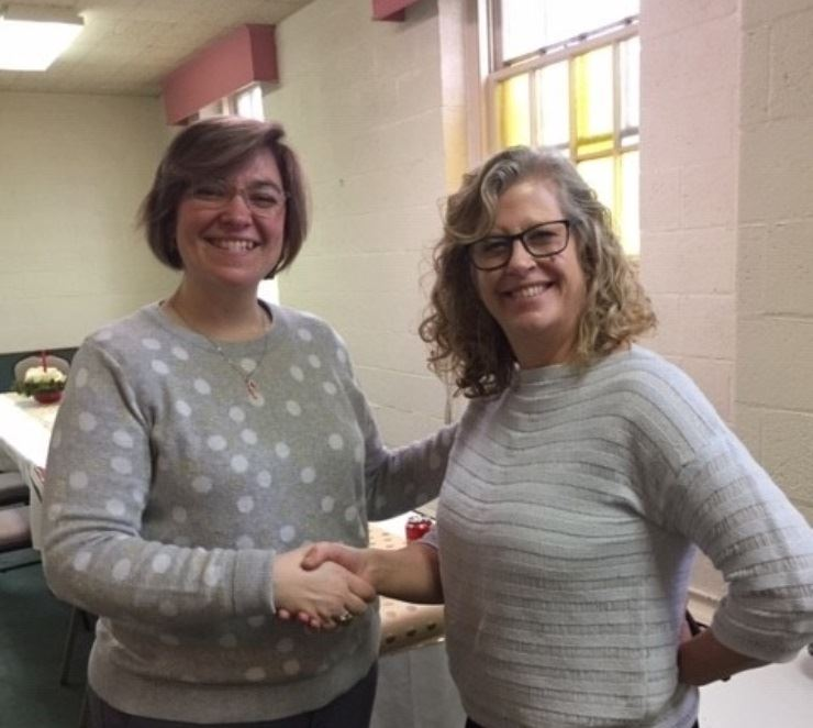 Tracey and Andrea shaking hands