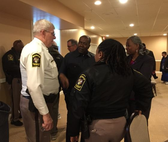 Lieutenant Enig Corporal Graddy speak with church pastor at Meet and Greet event