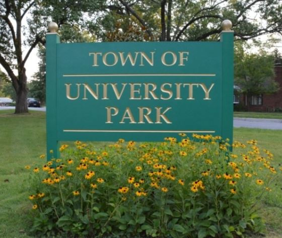 University Park green sign with gold lettering above black eyed susans