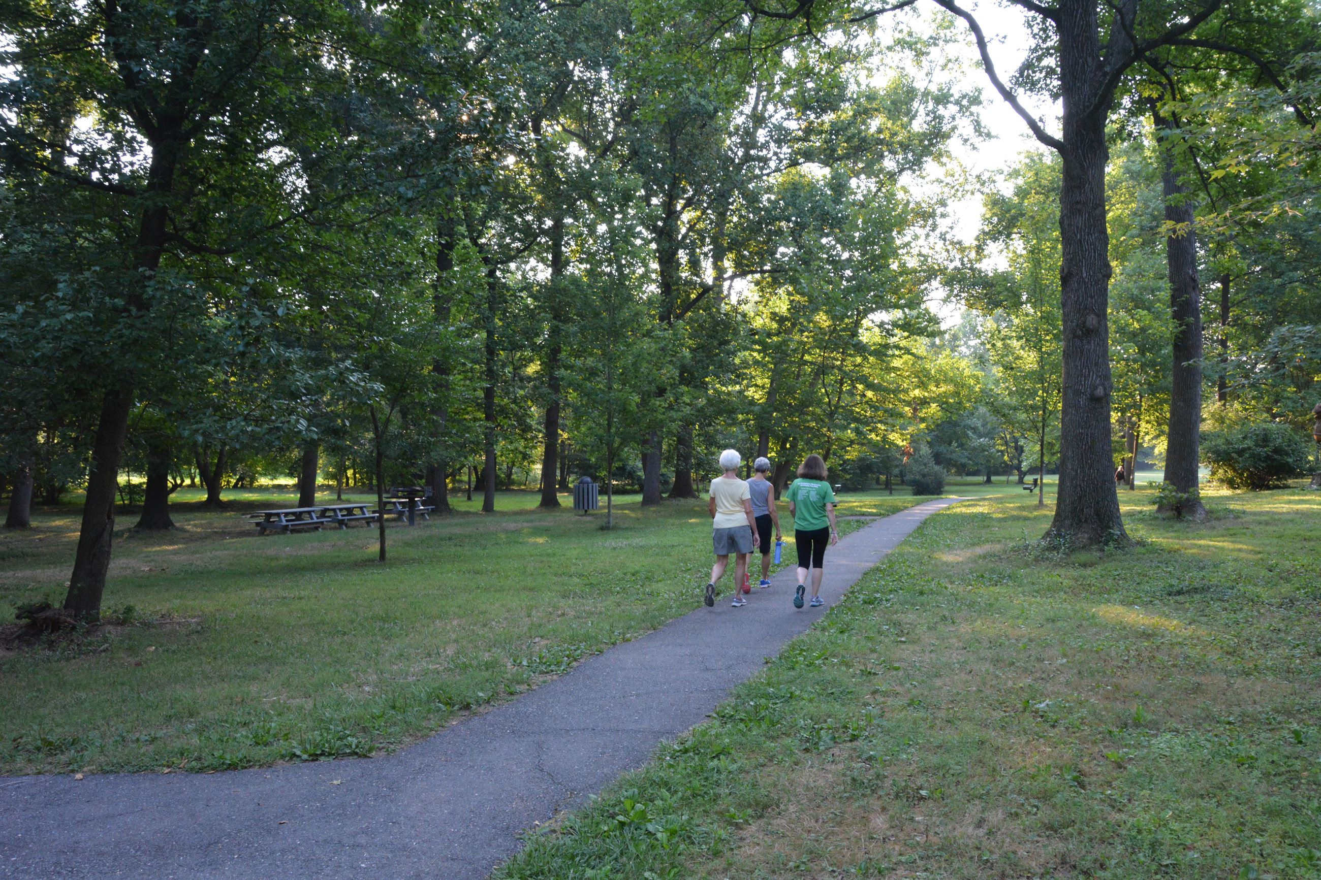 Town paved park trail with walkers